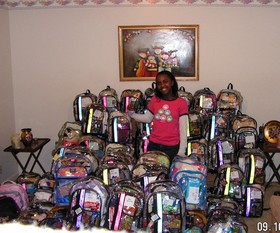 Taylor Rutledge showing the Katrina backpacks she made for the young victims of Hurricane Katrina.