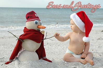 baby-on-beach-with-snowman.jpg