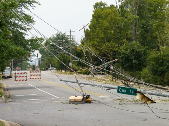 Straight line winds from a derecho storm caused downed power lines.