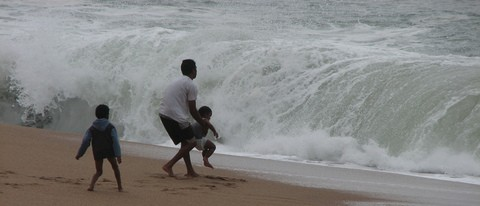 father-rescuing-child-from-crashing-waves-by-ThisParticularGreg.jpg
