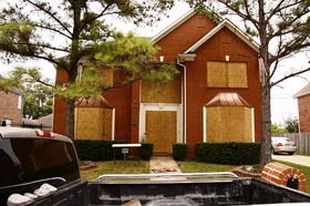 house-windows-boarded-up-for-hurricane.jpg