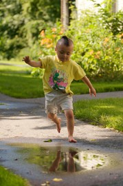 little-boy-puddle-jumping-by-rpscott123.jpg