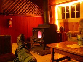 relaxing-by-wood-stove-by-Scrunchleface.jpg