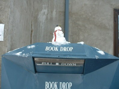 small-snowman-on-book-drop-by-ada-community-library.jpg